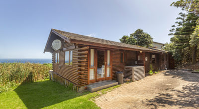 Classic wooden bungalow on the rocks